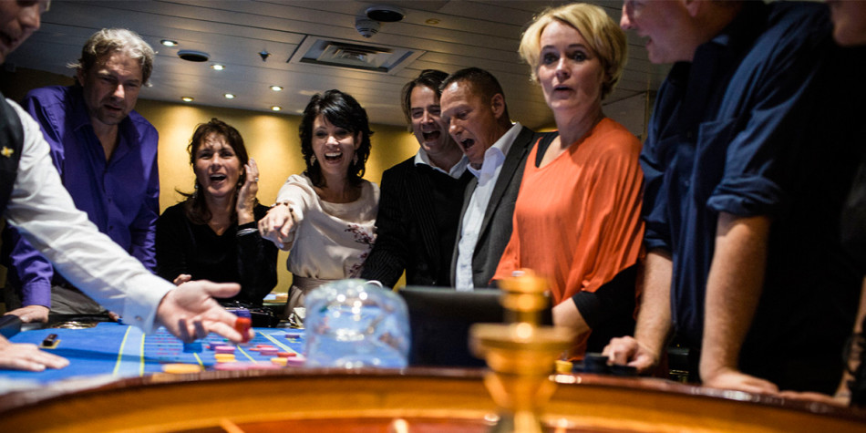 Friends enjoying themselves at the onboard Casino