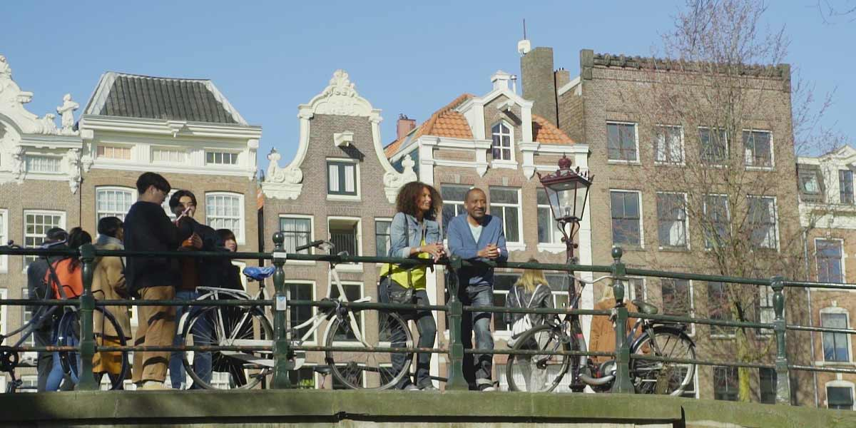 Group overlooking the canal in Amsterdam