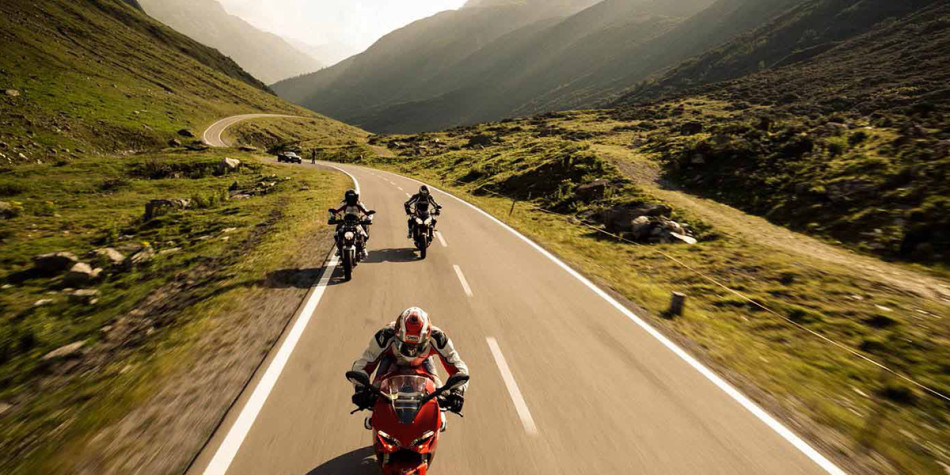 Group of 3 motorcycling on a road trip