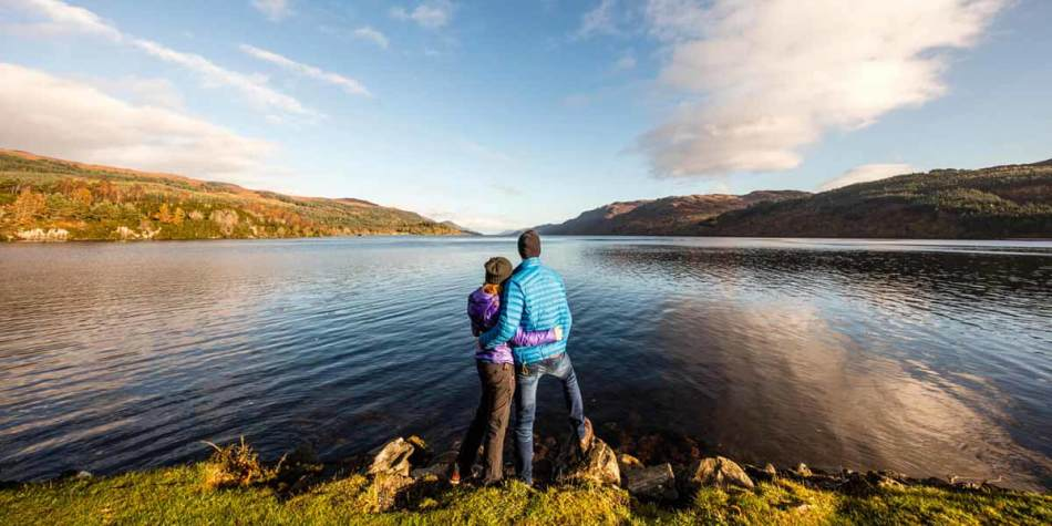 Couple looking over Loch Ness, Scotland