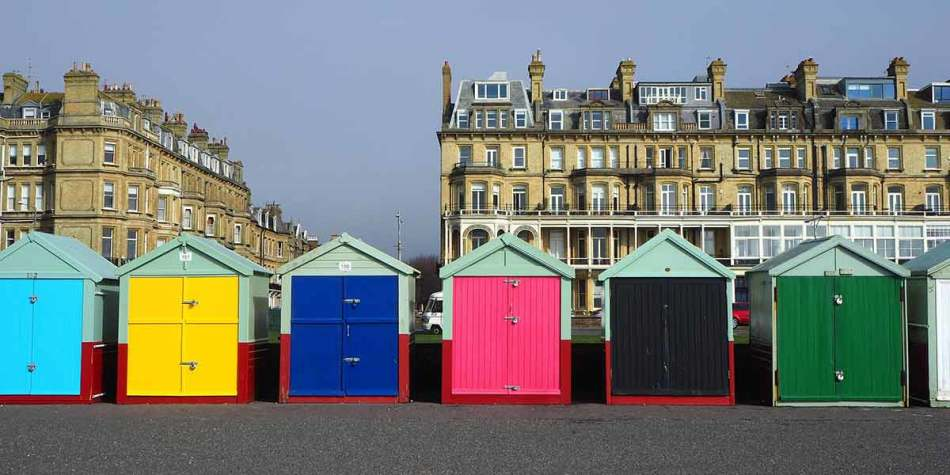 Colourful beach huts on brighton beach