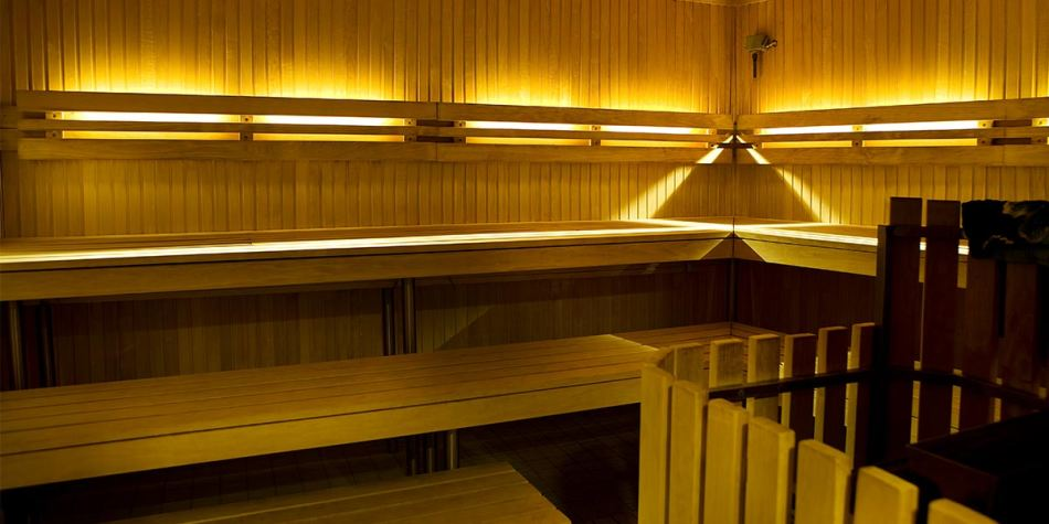 An onboard sauna showing the wooden benches and warm lights