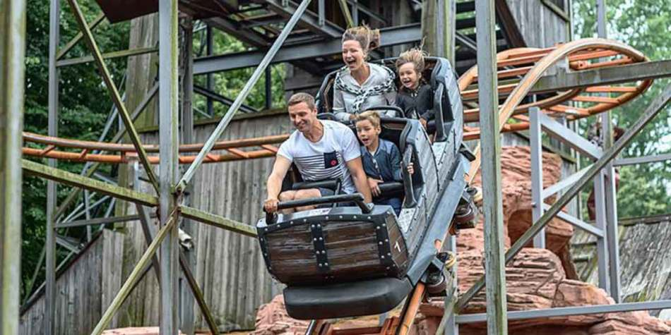 Family having fun on a rollercoaster at Hansa Park