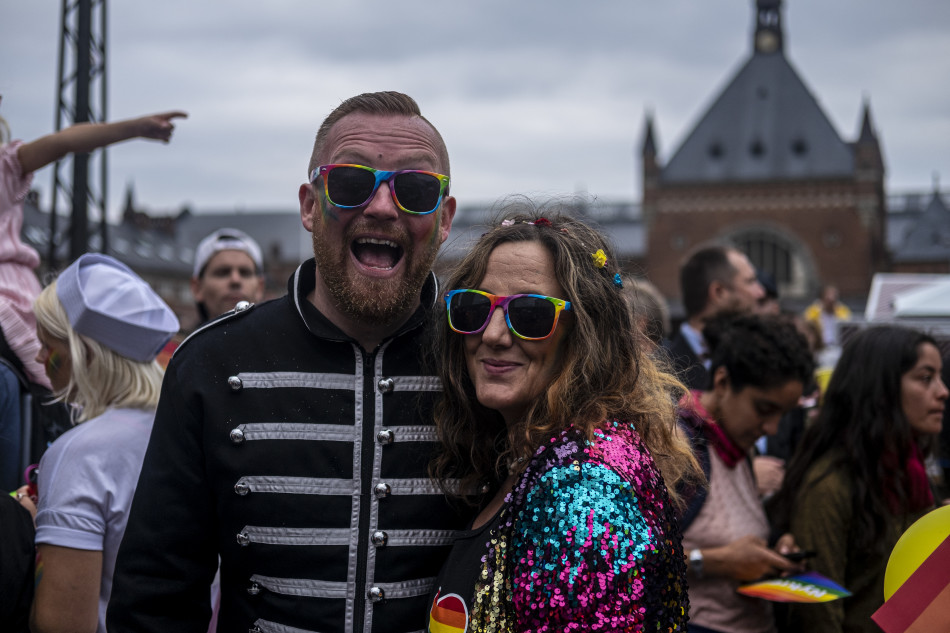 DFDS employees posing to the camera side by side during the Copenhagen Pride Parade 2019