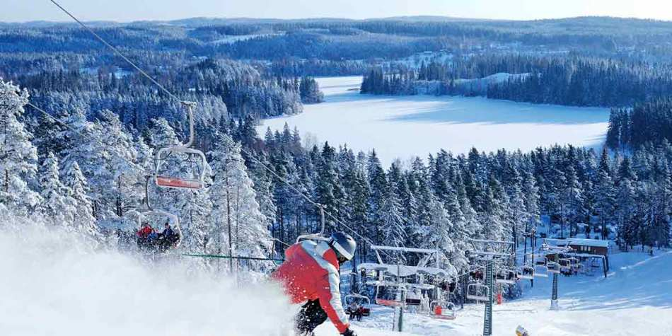 Person heading down a ski slope in Sweden