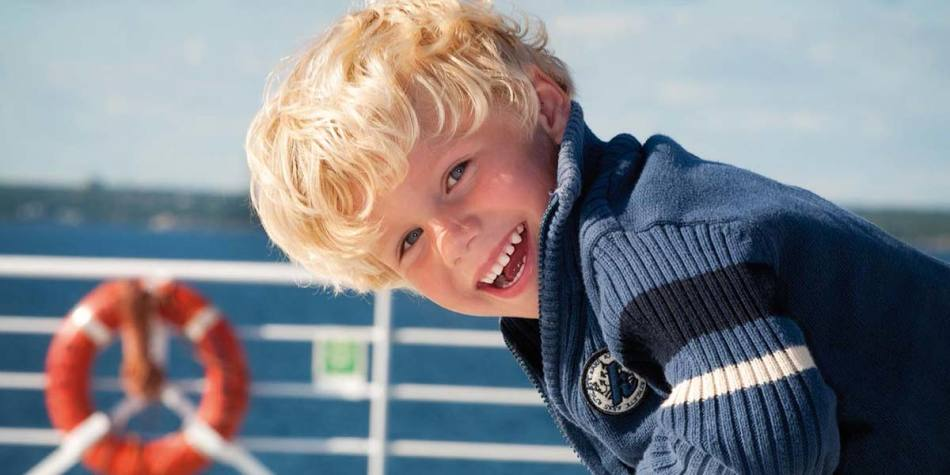 Young boy having fun onboard DFDS Optima Seaways ferry
