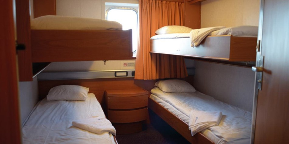 Four bunk beds in a standard sea view cabin