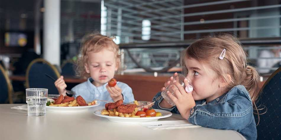 Children eating at self-service restaurant