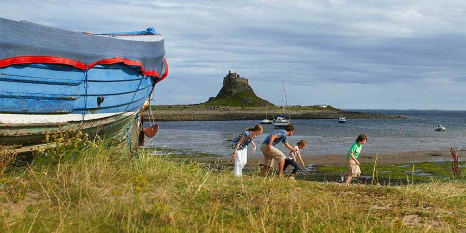 Family having fun on Lindisfarne coast