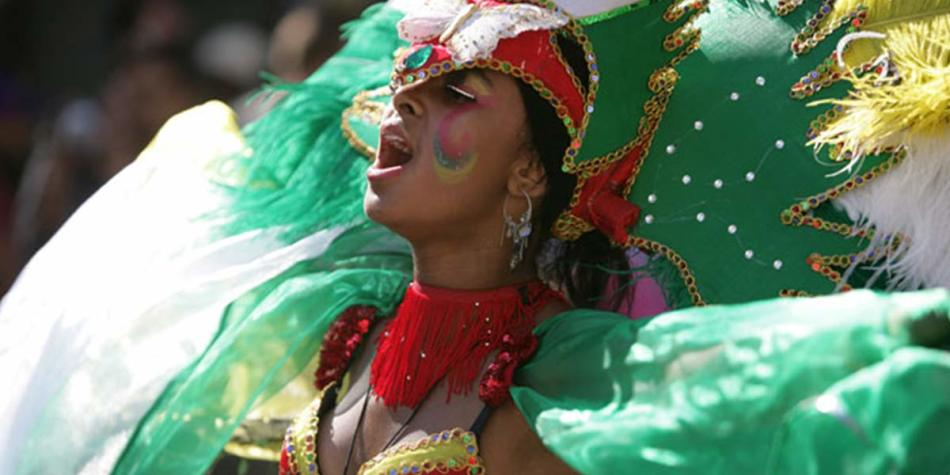 Woman performing at annual carnival with green costume