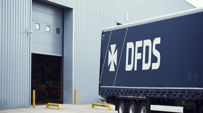 DFDS truck backing up to a warehouse