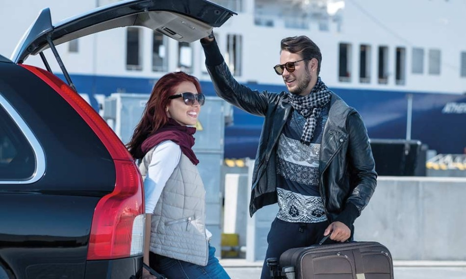 Couple packing their car for holiday on DFDS ferry