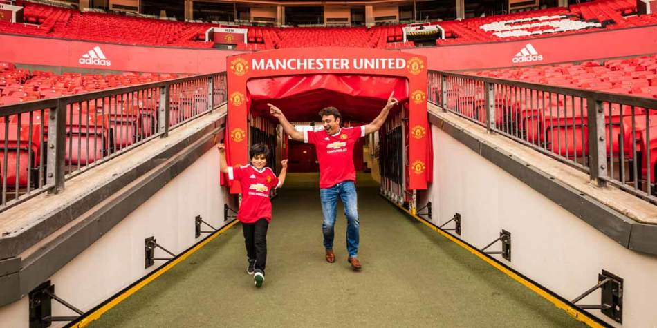 Man and boy at Manchester United stadium