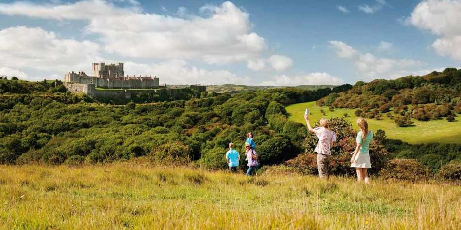 Dover castle in the distance on a sunny day