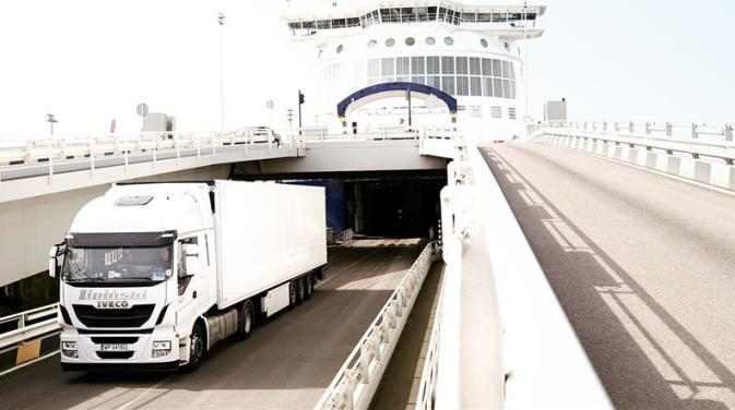 A DFDS Shipping truck disembarking from a ship