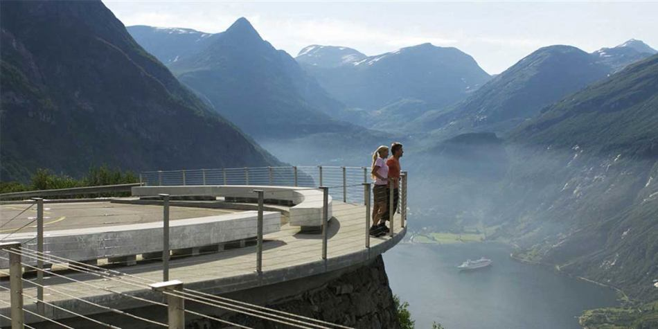 Couple watching nature and mountains in Norway