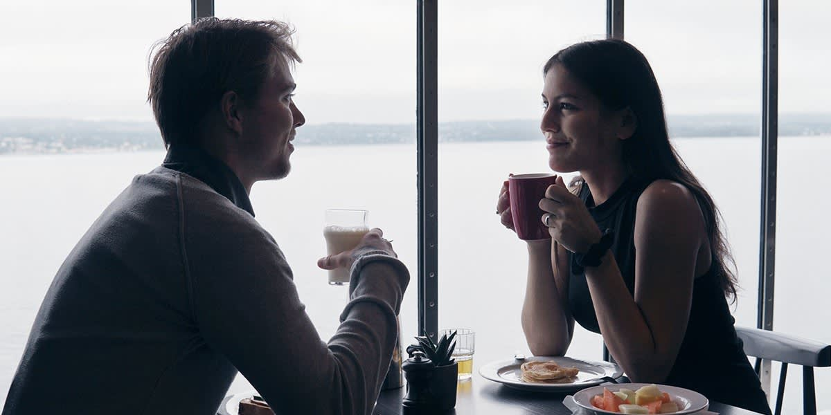 Couple having breakfast with a seaview