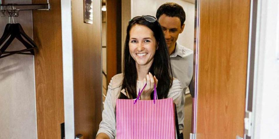 Couple happy about their tax free onboard shopping