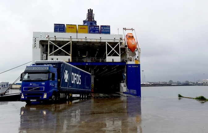 DFDS truck disembarking from the hold of a DFDS vessel