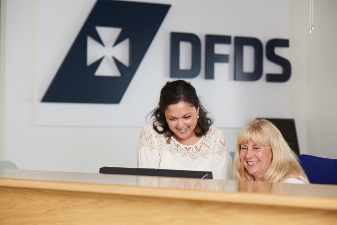 Two DFDS employees working in a DFDS office