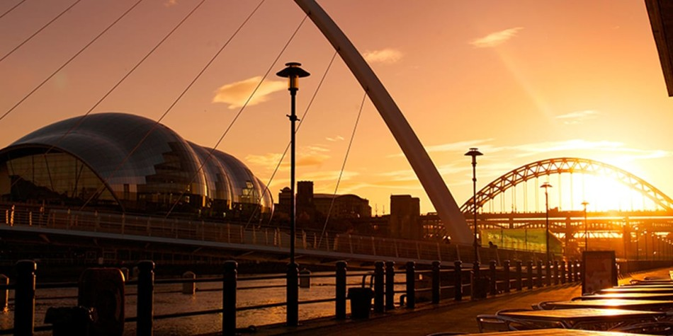 Sun setting on the bridges in Newcastle Quayside