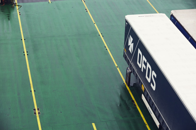 A DFDS trailer is parked