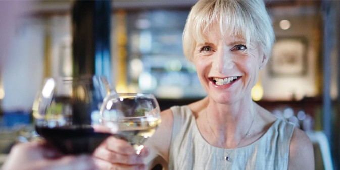 Woman drinking wine in DFDS onboard restaurant
