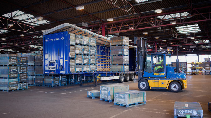 DFDS Logistics Warehouse forklift loading pallets into a container