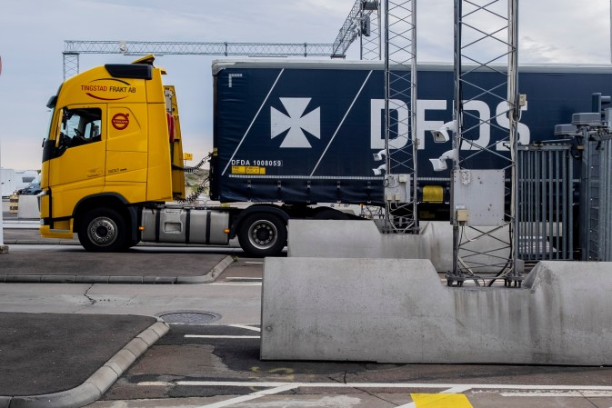 A DFDS Logistics truck entering a vessel at the terminal