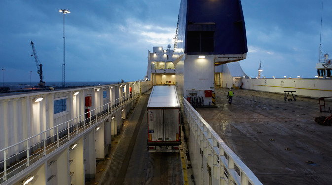 Logistics trucks on the deck of a DFDS vessel