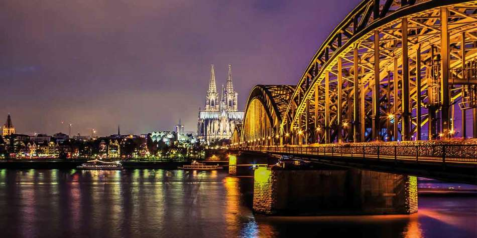 Bridge lit up at night in Cologne