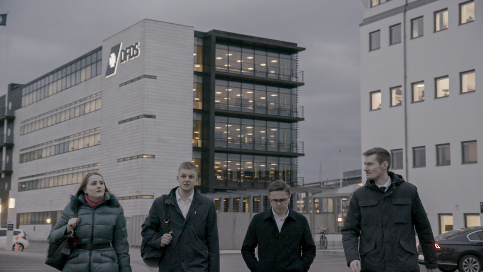 Four DFDS Freight shipping and Logistics trainees leaving the DFDS headquarters building