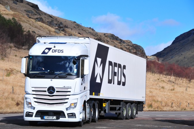 DFDS Logistics truck driving in the daytime