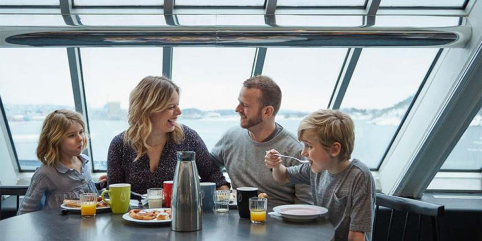 A family enjoying breakfast onboard