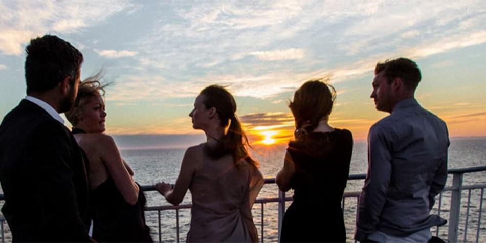 Friends enjoying the sunset on deck after the New Year party onboard