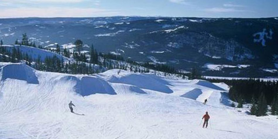 People enjoying ski slopes in Norway