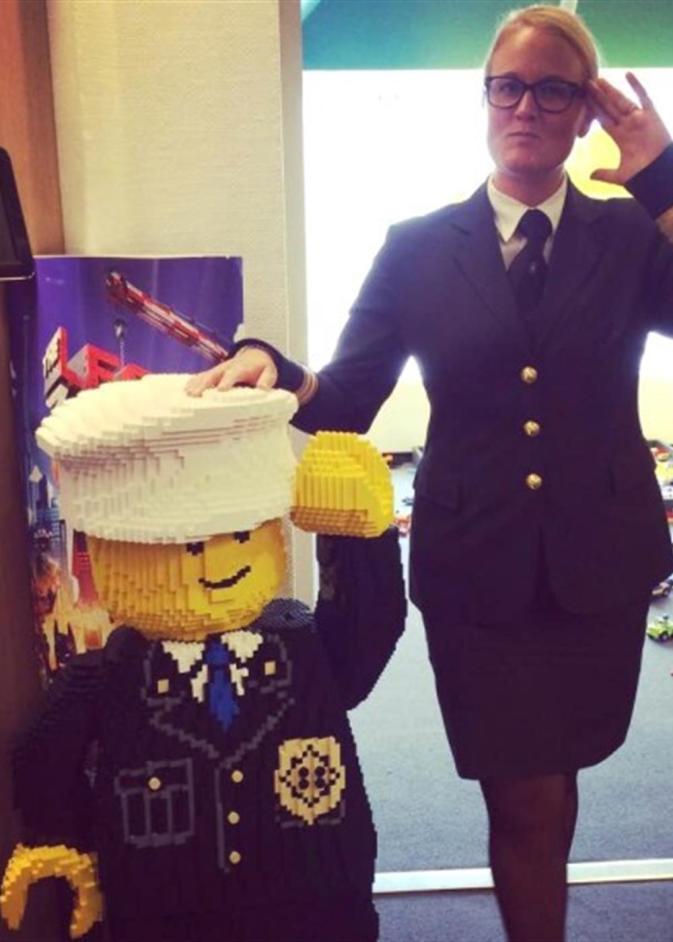 Photograph of Trine Skibelund Kristensen with Lego figure