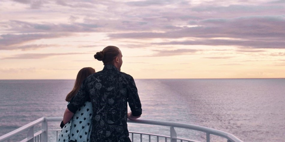 Couple on deck onboard DFDS ferry watching the sunset.