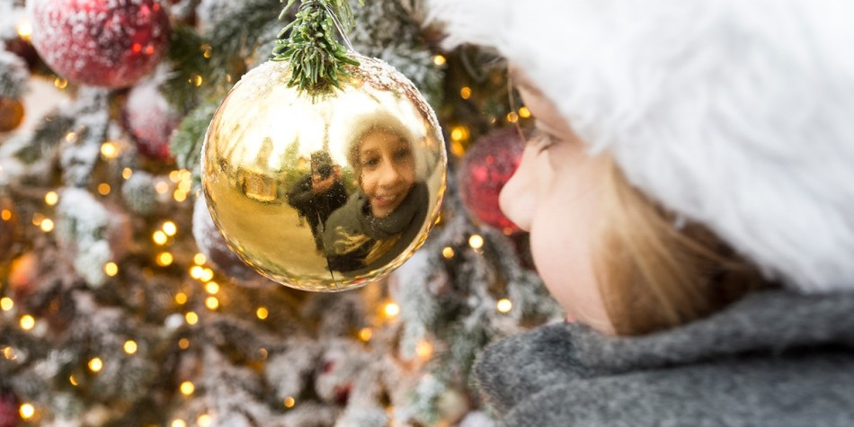 Girl reflected in a Christmas ball