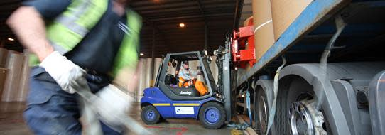 DFDS Logistics warehouse employees loading a truck, cropped image