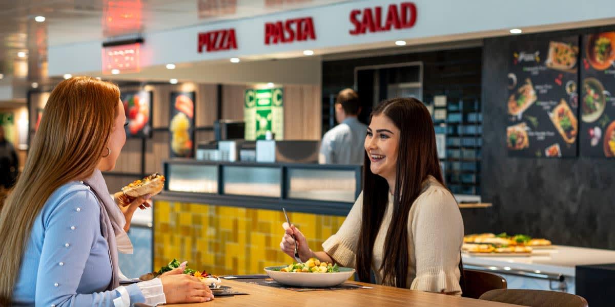Friends enjoying food in the Horizon restaurant