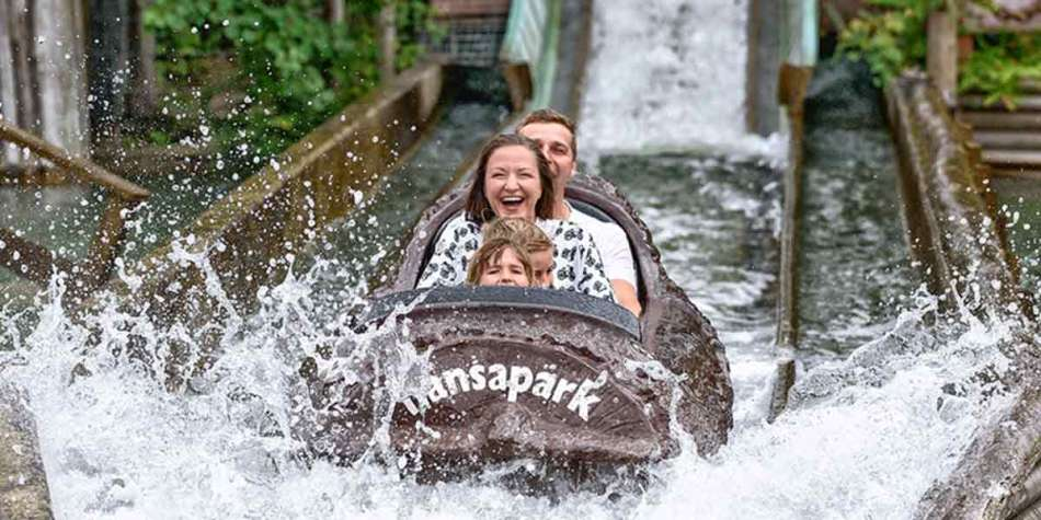 Family on a water flume ride at Hansa Park, Germany