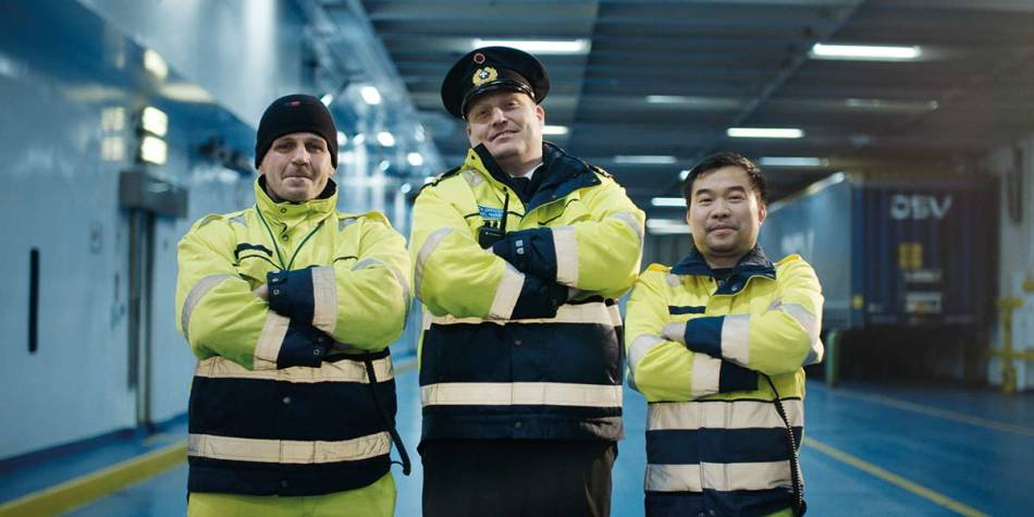 Three DFDS ground staff smiling together