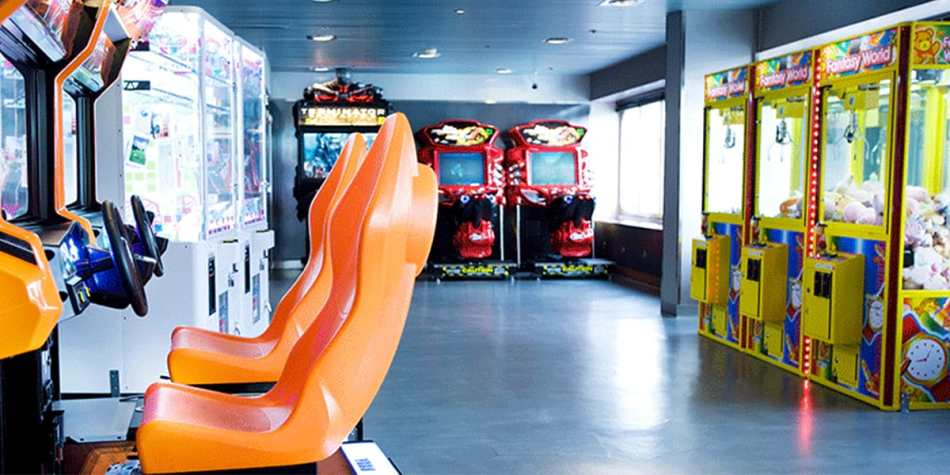 Arcade with racing simulators and claw machines onboard.