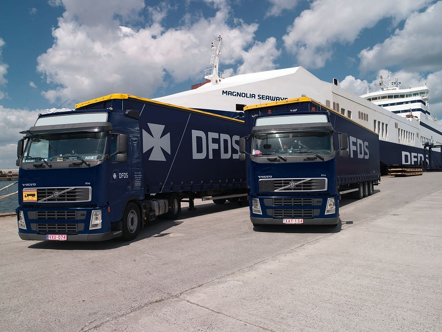 DFDS Logistics trucks in front of Magnolia Seaways, a DFDS Freight vesssel