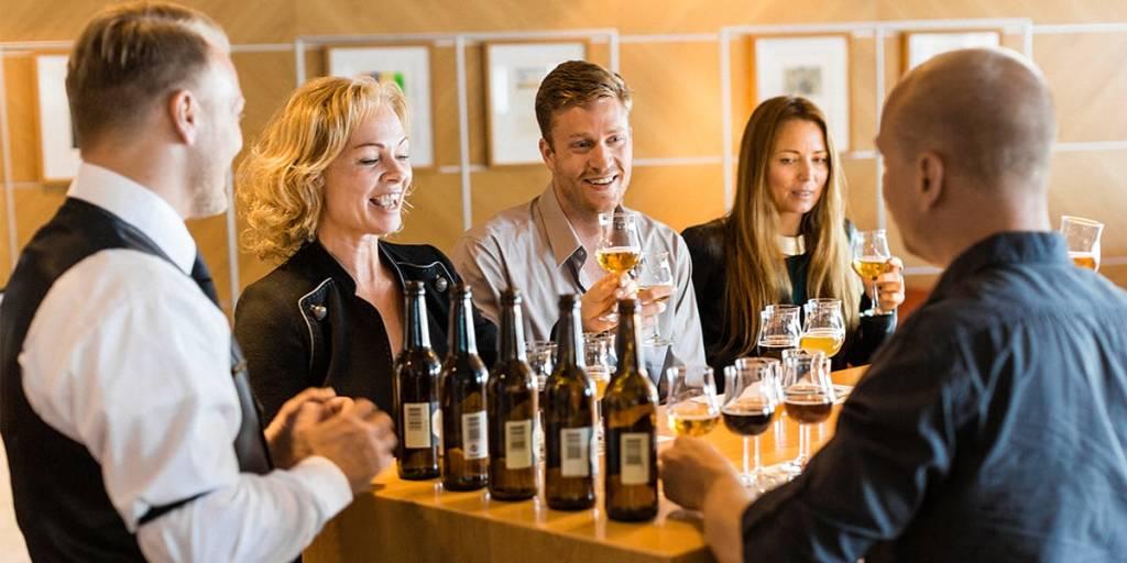 Guests in wine bar onboard Copenhagen-Oslo