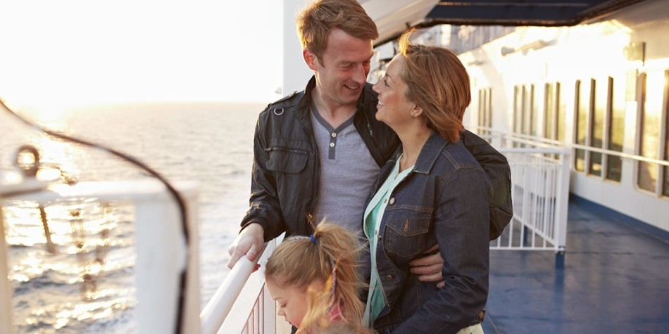 young family on the deck of a DFDS ferry at sunset