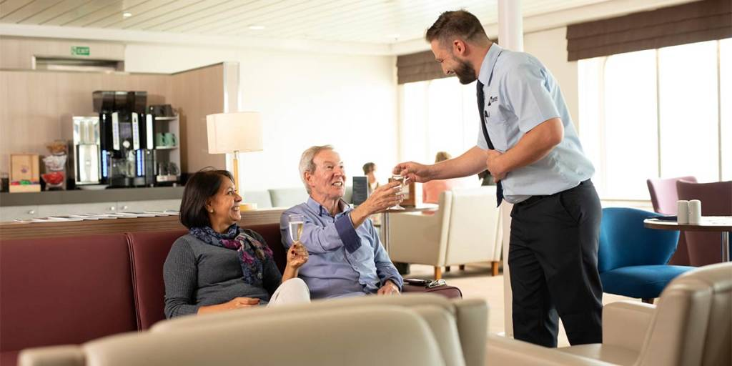 Couple in Premium Lounge onboard Dover-France