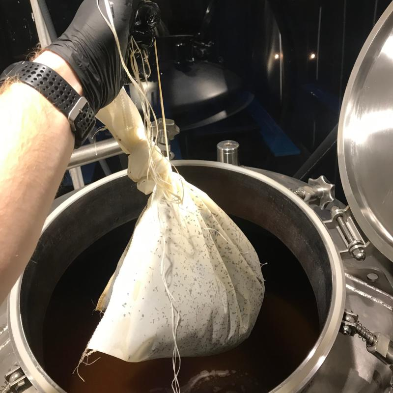 Adding a giant tea bag to a beer