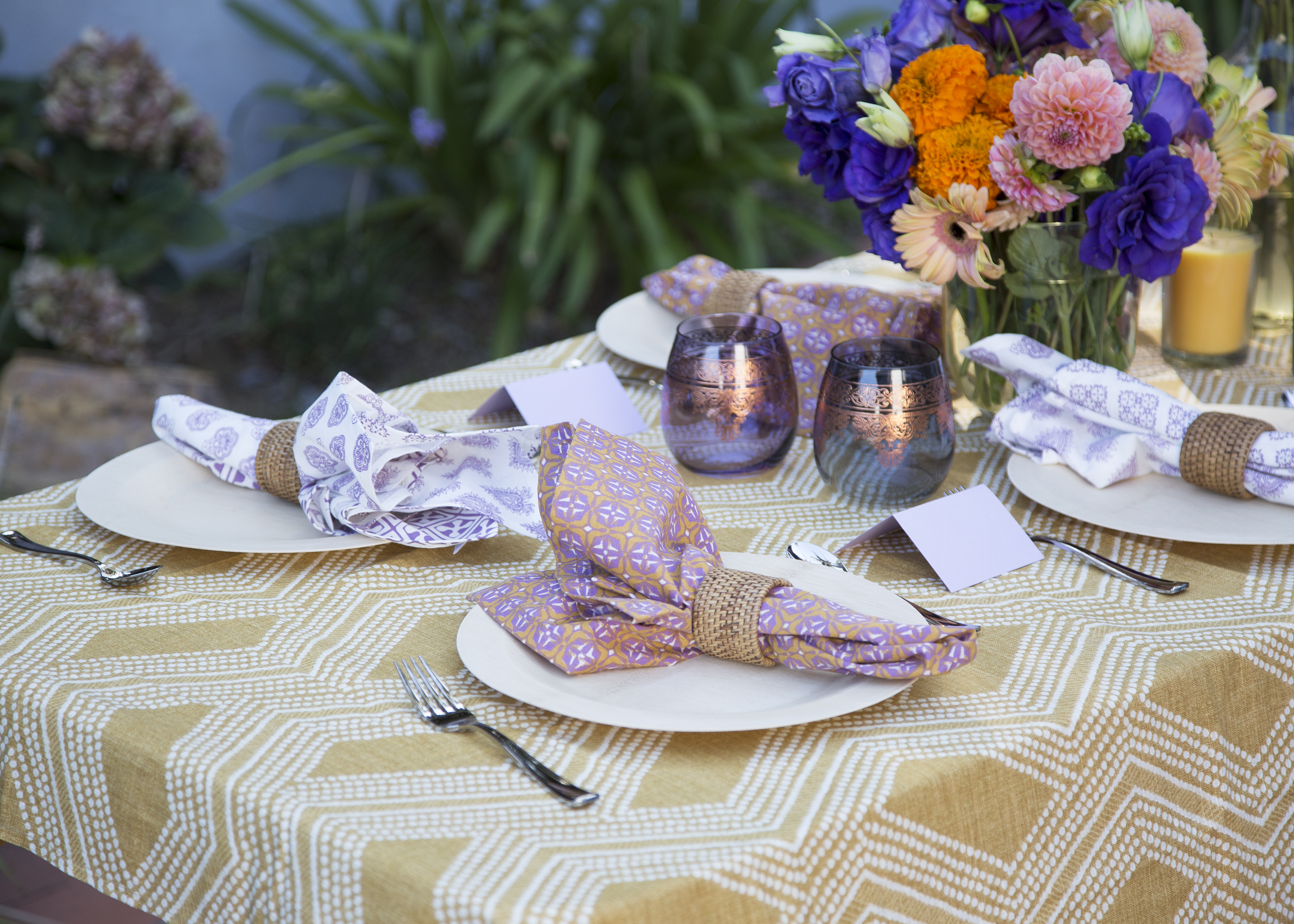 Both Mustard Hued And Ombre Glass Candles Filled The Table; Woven Napkin  Rings Were Combined With Fabric Napkins In 3 Different Prints.